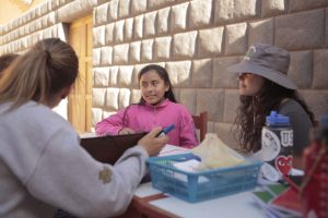 2017 STRIVE students working in STRIVE Center after-school English classes at the Pisac Community Museum